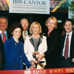 Ribbon cutting for the Iris Cantor Women's Health Center at New York-Presbyterian Hospital, 2002.  Joining Mrs. Cantor (center) are (from left) Dr. Antonio Gotto, dean of the Medical College; Sanford Weill, chairman of Weill Cornell's Board of Overseers; Dr. Orli Etingin, director of the Iris Cantor Women's Health Center; Frank Bennack Jr., vice chairman of NewYork-Presbyterian Hospital's Board of Trustees; Libby Pataki, first lady of New York; Dr. Thomas Frieden, NYC Commissioner of Health; and Dr. Herbert Pardes, president of NewYork-Presbyterian Healthcare System