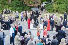 Dixon Gallery and Gardens members enjoy a warm October evening at the opening reception for the Rodin exhibition. Watching it all is Rodin's monumental 'The Three Shades.'